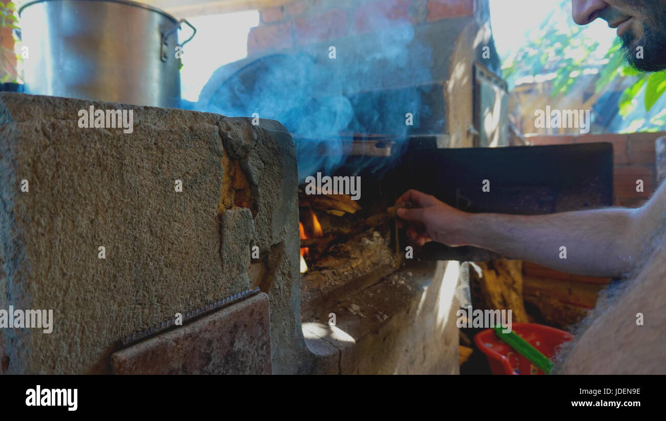 Lighting a wood oven - Stock Image