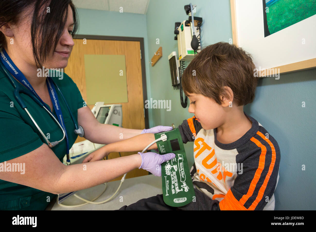 A six-year-old boy with type 1 diabetes (also called juvenile diabetes) has a checkup at a hospital. also called - Stock Image