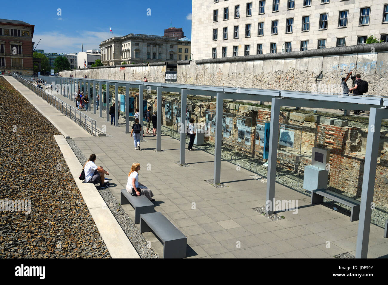 Exhibition Topography of the Terror, at back Wall Remains and the Detlev-Rohwedder House, Berlin, Germany - Stock Image