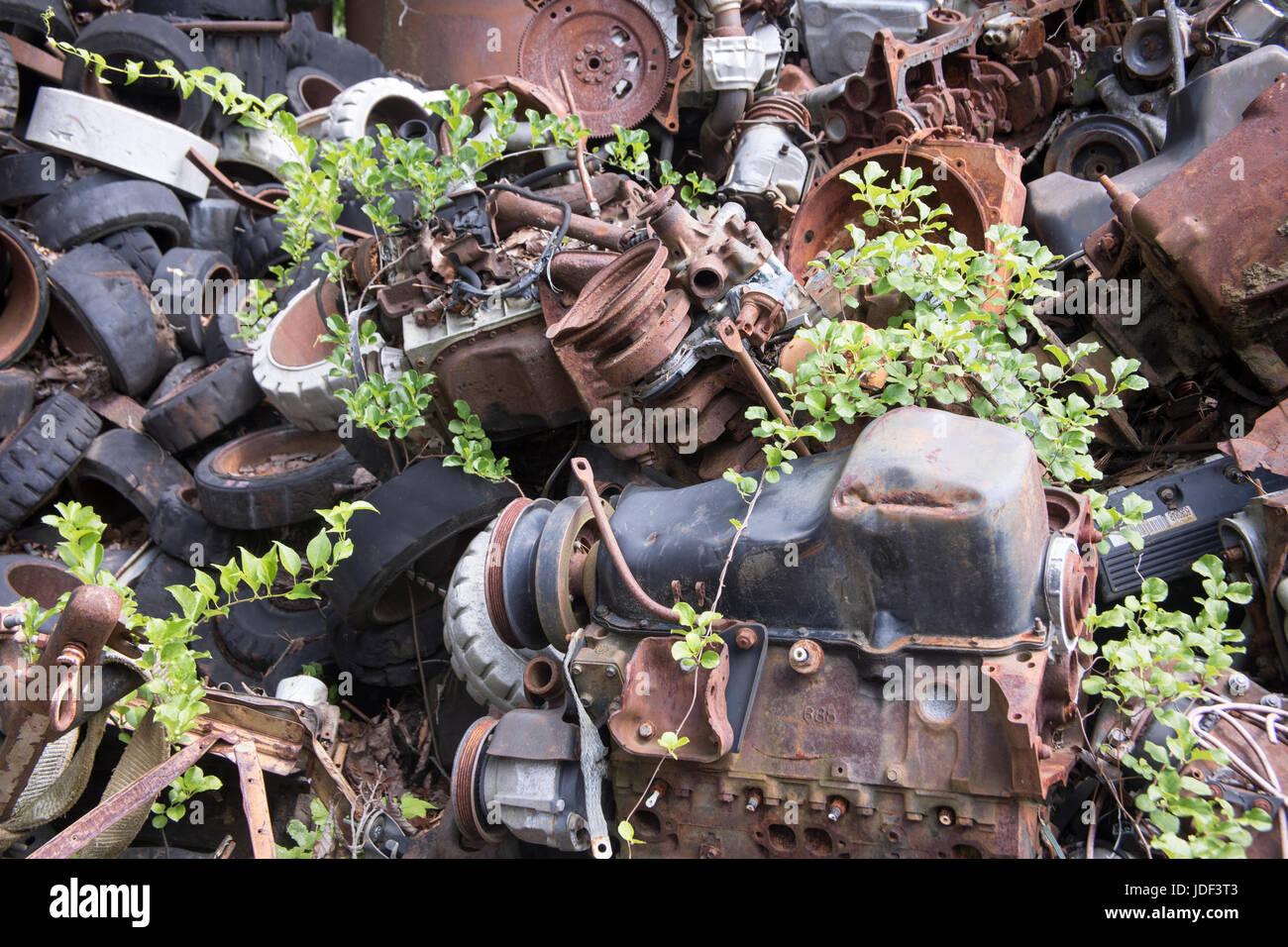 Rusting scrap metal from old cars and equipment in junkyard Stock ...