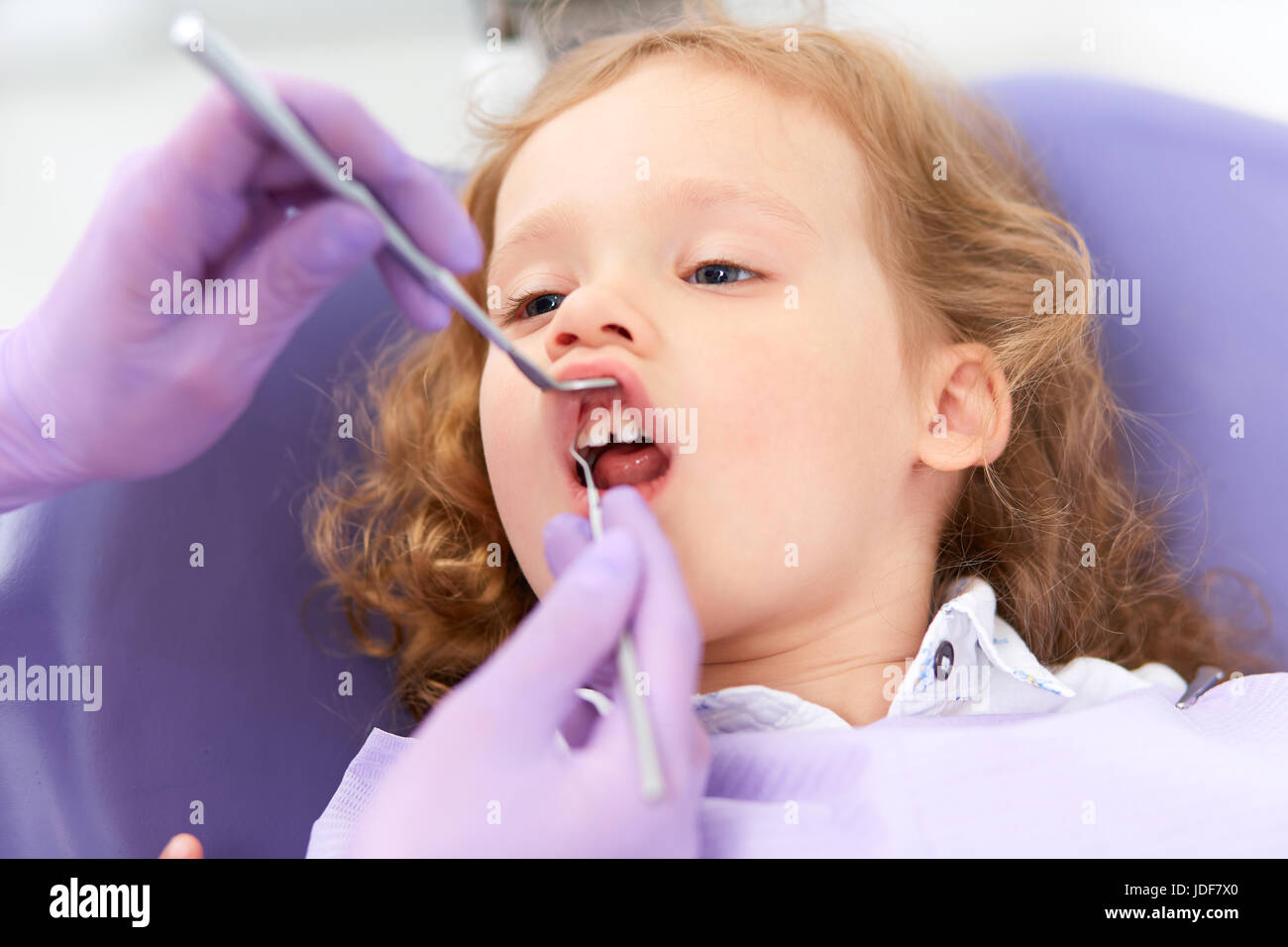 Dentist examining under lip - Stock Image
