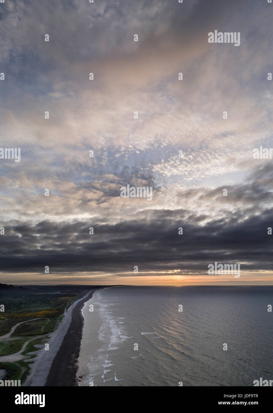 Sunset at Kingston on Spey, looking towards Lossiemouth, aerial images. - Stock Image