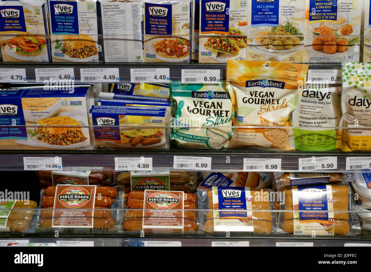 Packaged vegan food products for sale in a grocery store, Vancouver, British Columbia, Canada - Stock Image