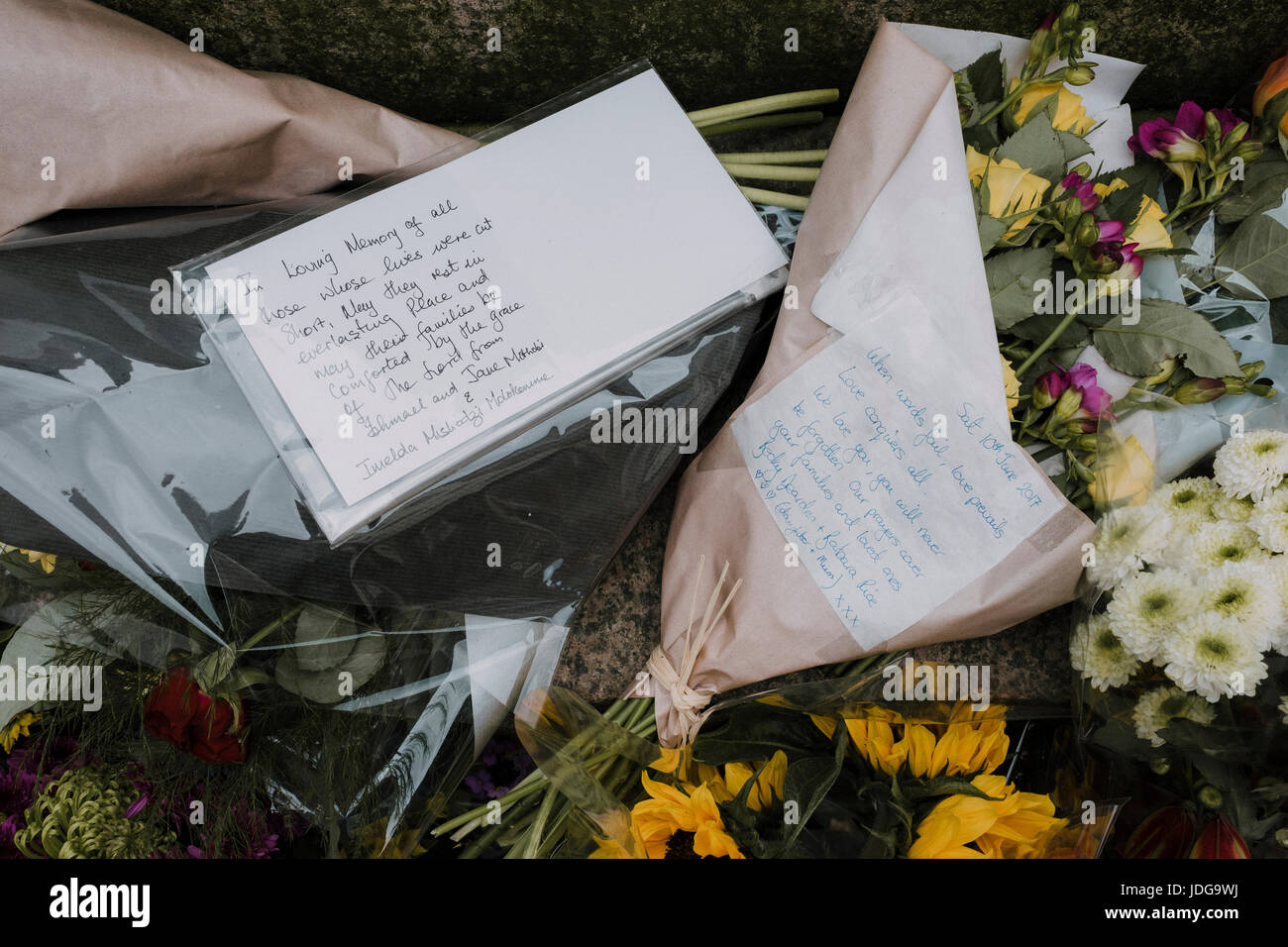 Memorials left at St Ann's Square for the victims of the Manchester Arena terror attack on 22nd May 2017 and - Stock Image