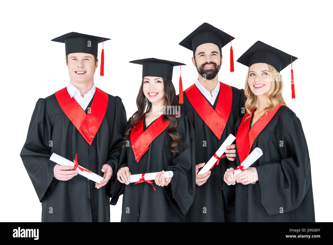 f636292a17f Group of young men and women in graduation gowns and mortarboards holding  diplomas - Stock Image