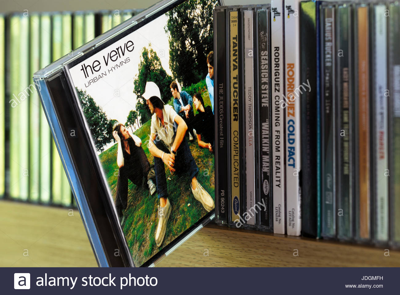Urban Hymns, The Verve CD pulled out from among other CD's on a shelf, Dorset, England Stock Photo