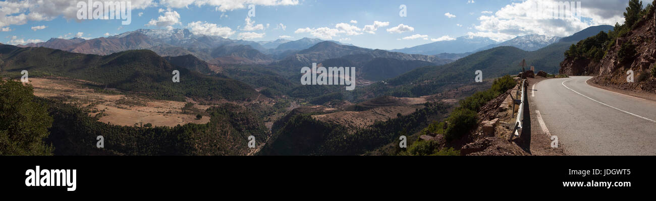A deep gorge cuts through the arid scenery of the Atlas mountains in Morocco Stock Photo