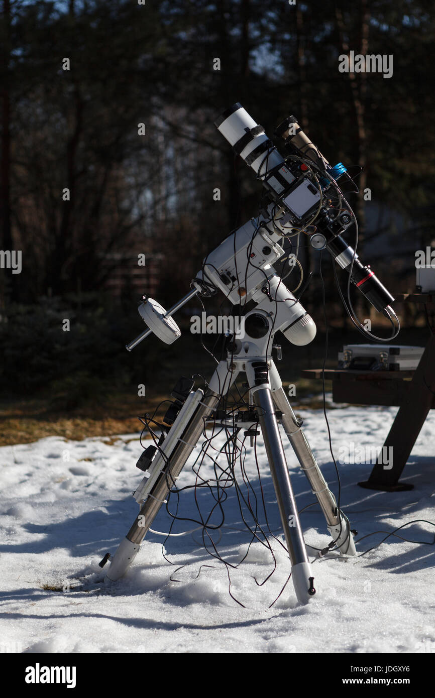 Professional astrophotography telescope equipped with guider scope and astro camera ready for night session - Stock Image