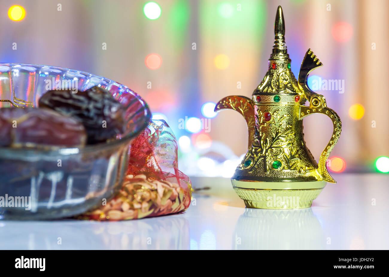 Golden Arabic Coffee Pot with illuminated background. Ramadan, Eid Concept background. - Stock Image