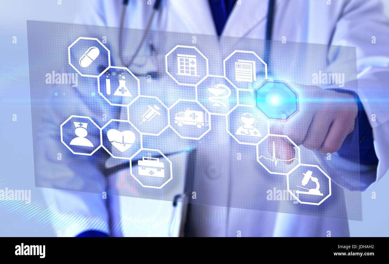 Representation communication fields of medicine and globalization with doctor picking futuristic representation - Stock Image