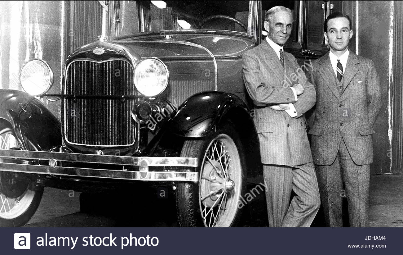 Henry ford standing beside model t stock image
