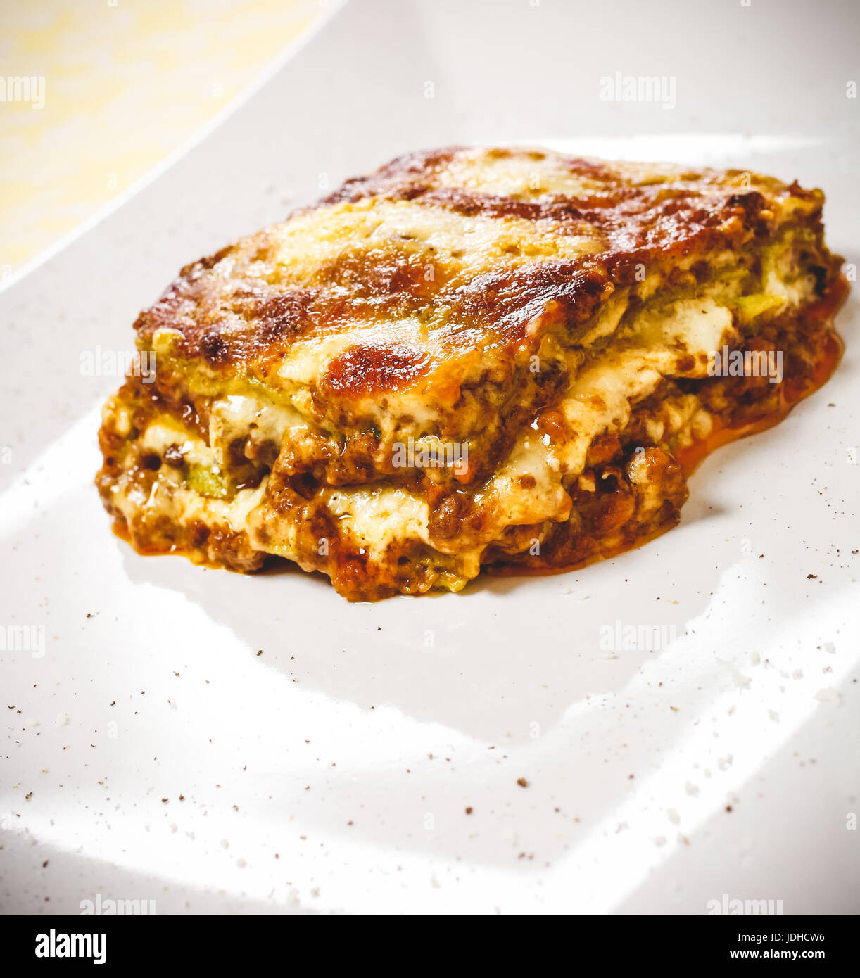 Lasagna bolognese. Typical homemade fresh green pasta cooked in oven. A portion in plate. - Stock Image