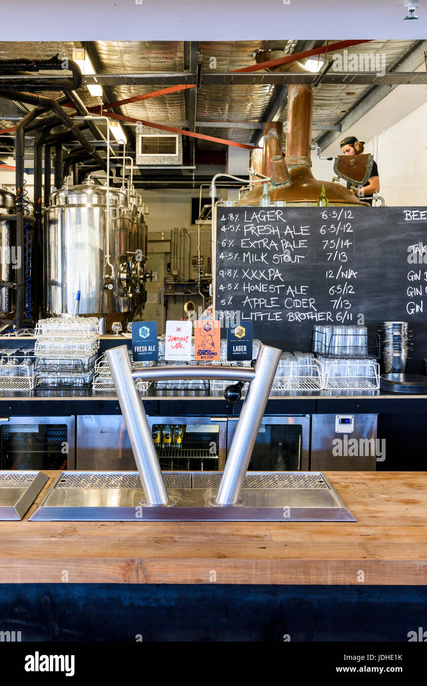 Beer taps and brewery at the Black Brewing Co. including Taj Burrow's new beer on tap, Honest Ale, Wilyabrup, Margaret - Stock Image