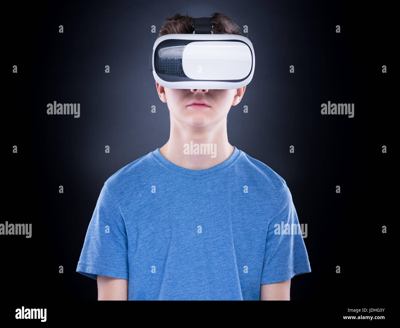 903ab3fda277 Happy teen boy wearing virtual reality goggles watching movies or playing  video games. Cheerful smiling teenager looking in VR glasses. Funny child ex