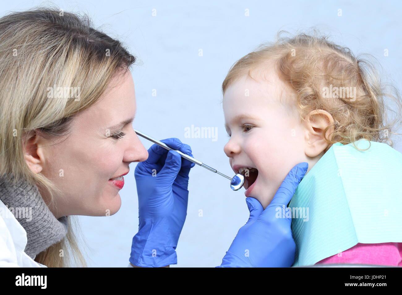 A dentist, child, infant, happy, children doctor - Stock Image