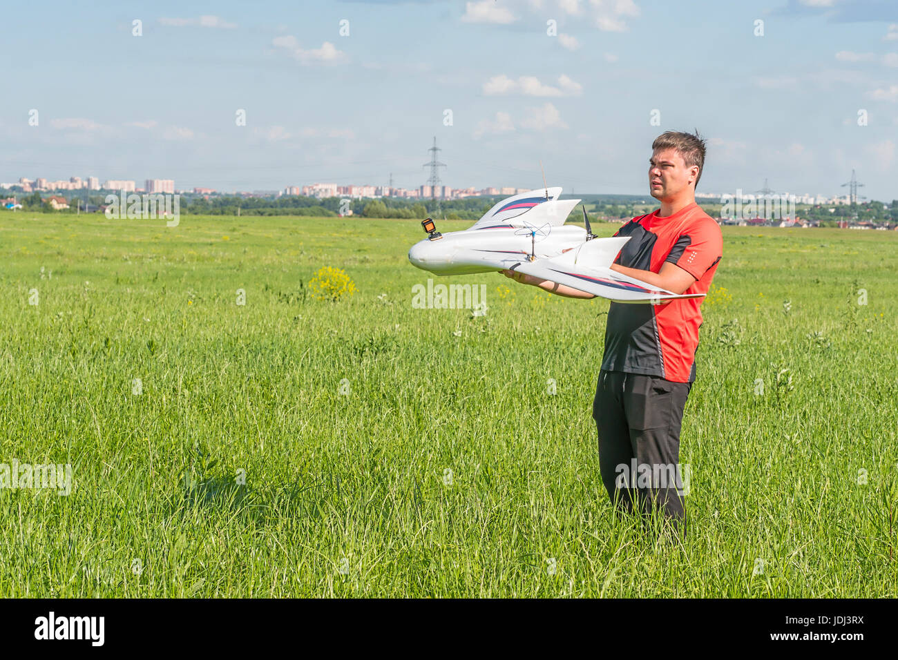 Man with rc fpv model wing. Electronics, hobby, aeromodelling concept - Stock Image