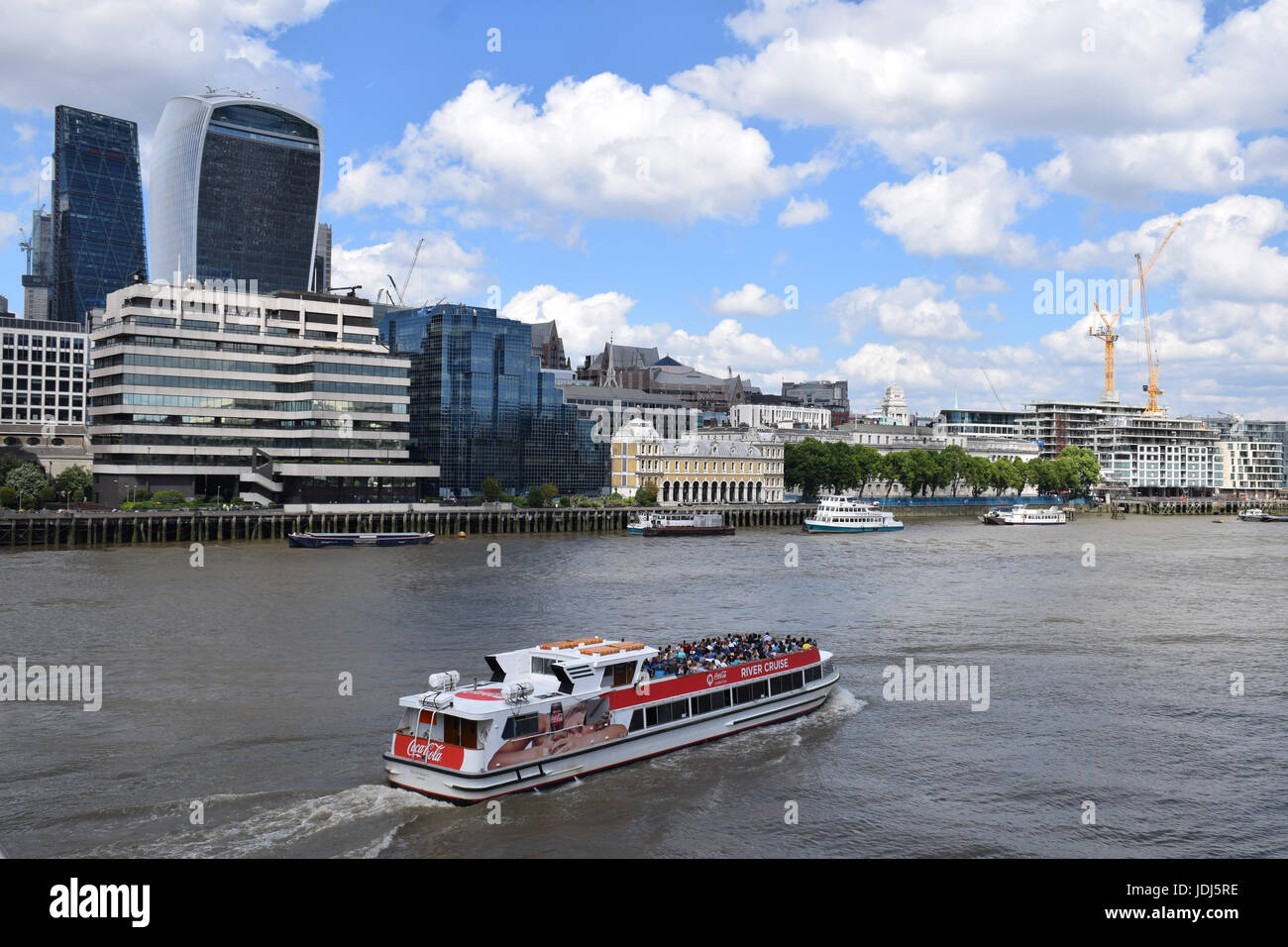 Tour boat on River Thames. In the background: City of London - 20 Fenchurch Street (Walkie Talkie building) and - Stock Image