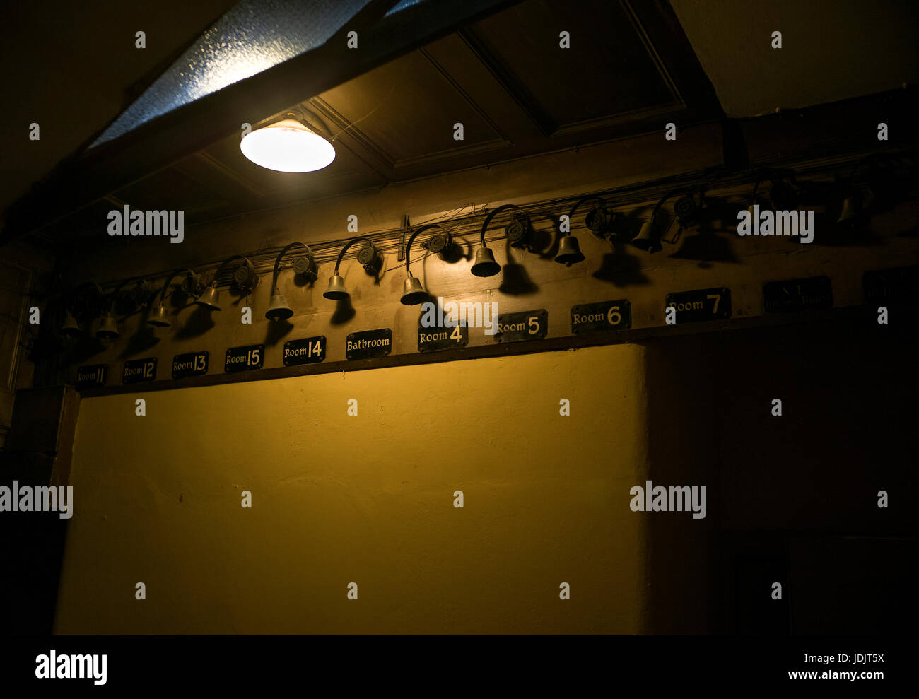 below stairs Servant's bells in a large old house - Stock Image