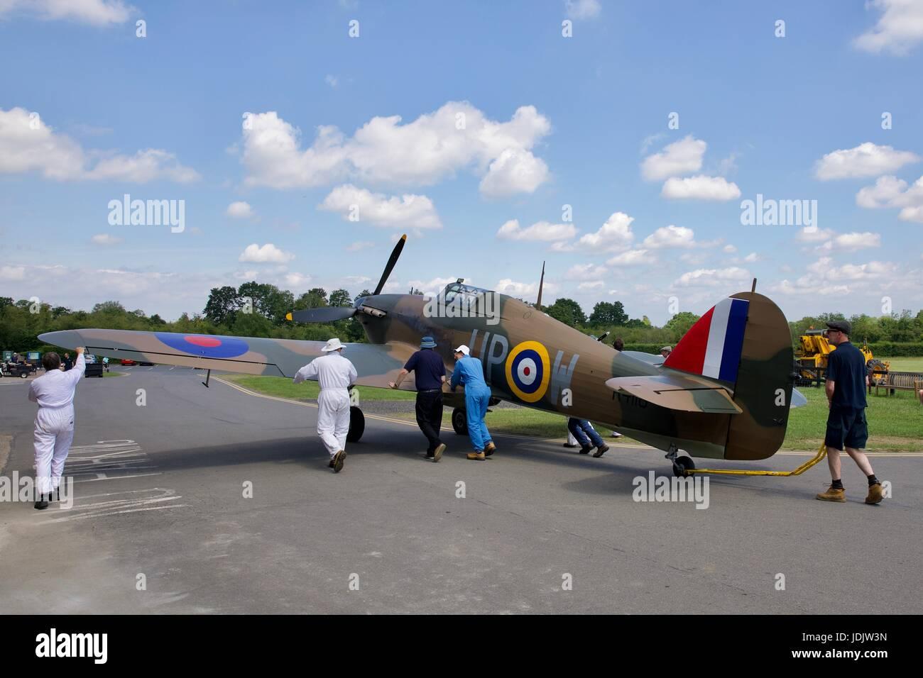 Shuttleworth ground crew moving the Hawker Hurricane Mk1 R4118 - Stock Image