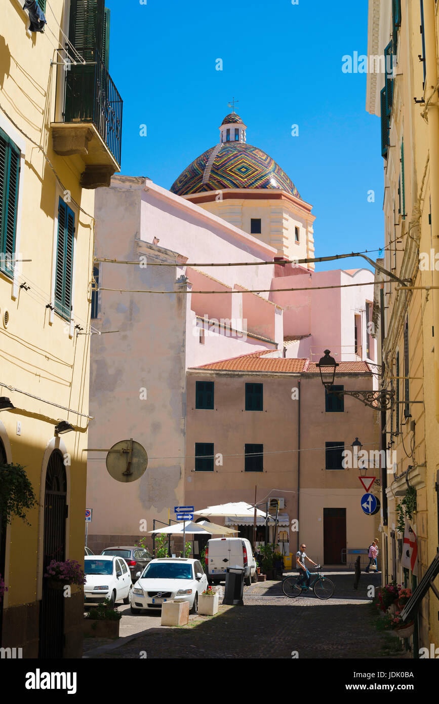 Alghero Sardinia, view of the San Michele church with its famous majolica-tiled dome in the old town area of Alghero, Stock Photo