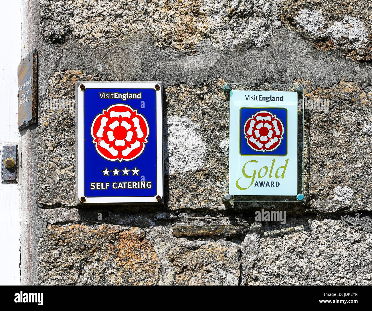 Visit England self catering signs, 4 star and gold award on a cottage wall at Hugh Town St. Mary's, Isles of Scilly, Stock Photo