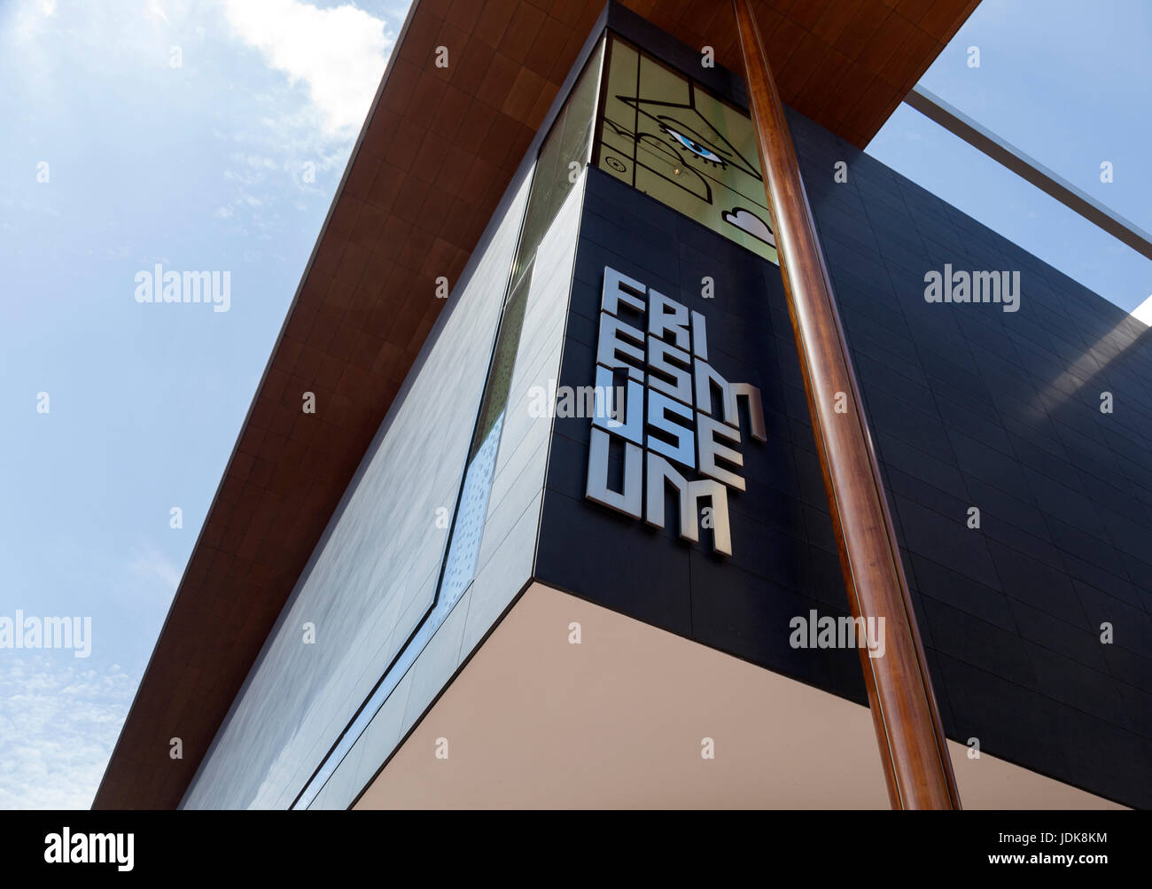 Leeuwarden, Netherlands, 11 june 2017: part of fries museum in leeuwarden with blue sky - Stock Image