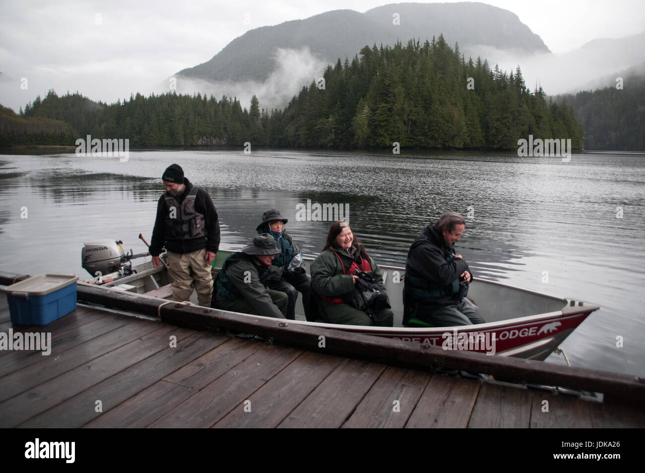 Tourists in a motorboat embarking on a bear viewing ecotour in the Great Bear Rainforest, British Columbia, Canada. - Stock Image