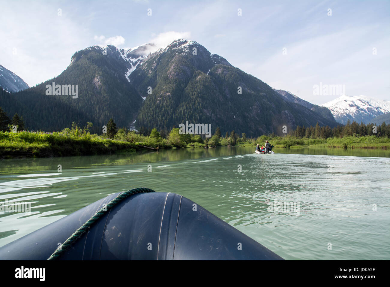 Tourists in a Zodiac boats on a nature viewing ecotour in an estuary in the Great Bear Rainforest, British Columbia, - Stock Image