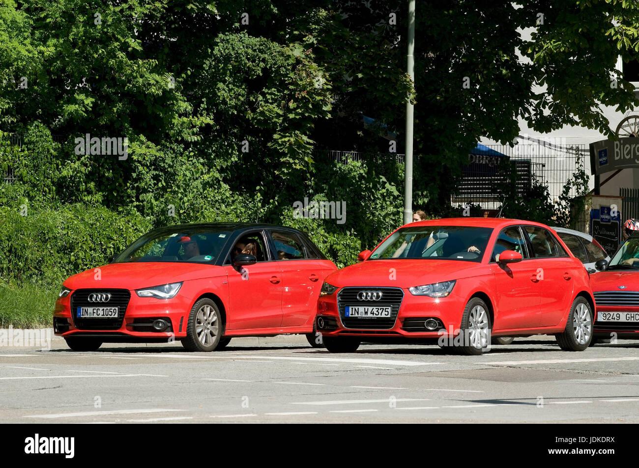 Europe, Germany, Bavaria, Ingolstadt, two red Audi models, , Europa, Deutschland, Bayern,  zwei rote Audi-Modelle - Stock Image