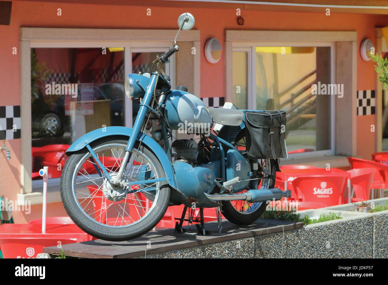 Vernayaz, Martigny, Switzerland. Old motorcycle in interior of Joe Bar Team cafe Stock Photo