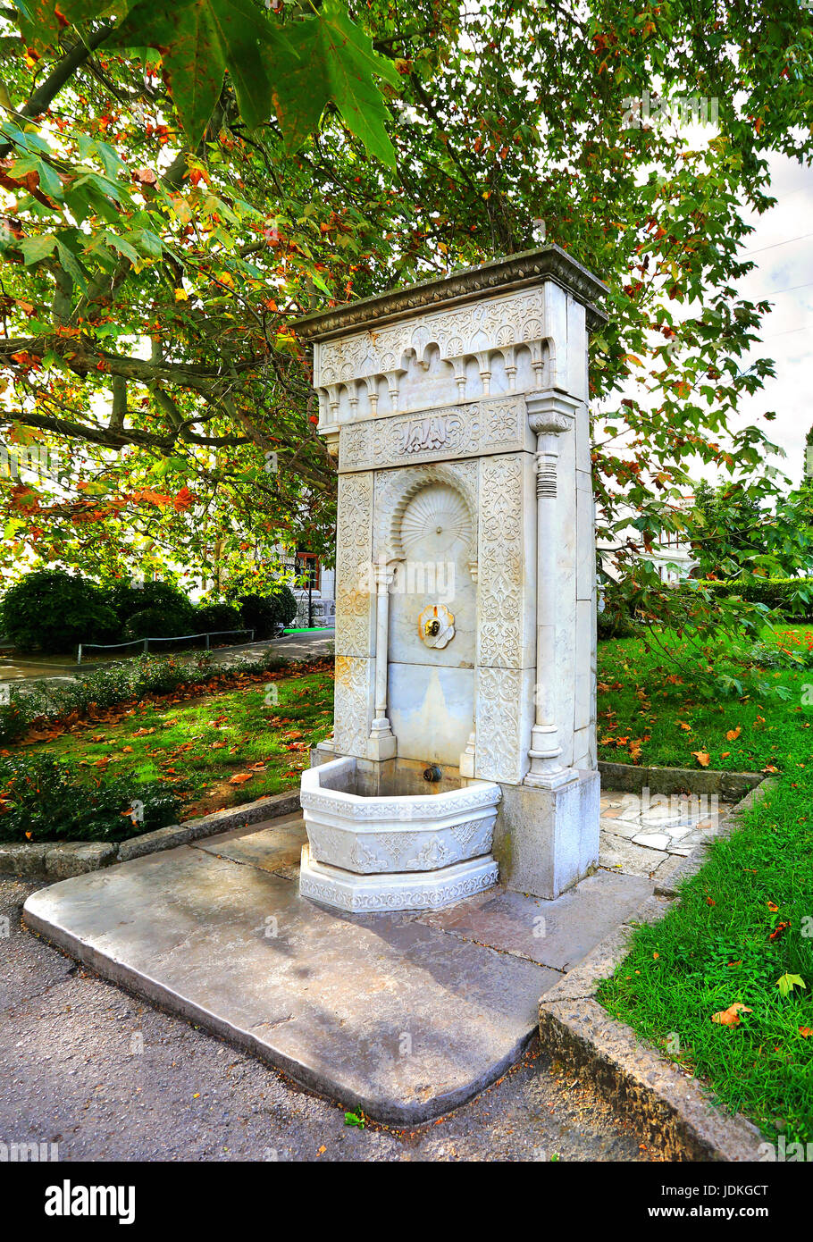 Fountain spring in a Moorish style with stone carvings - Stock Image