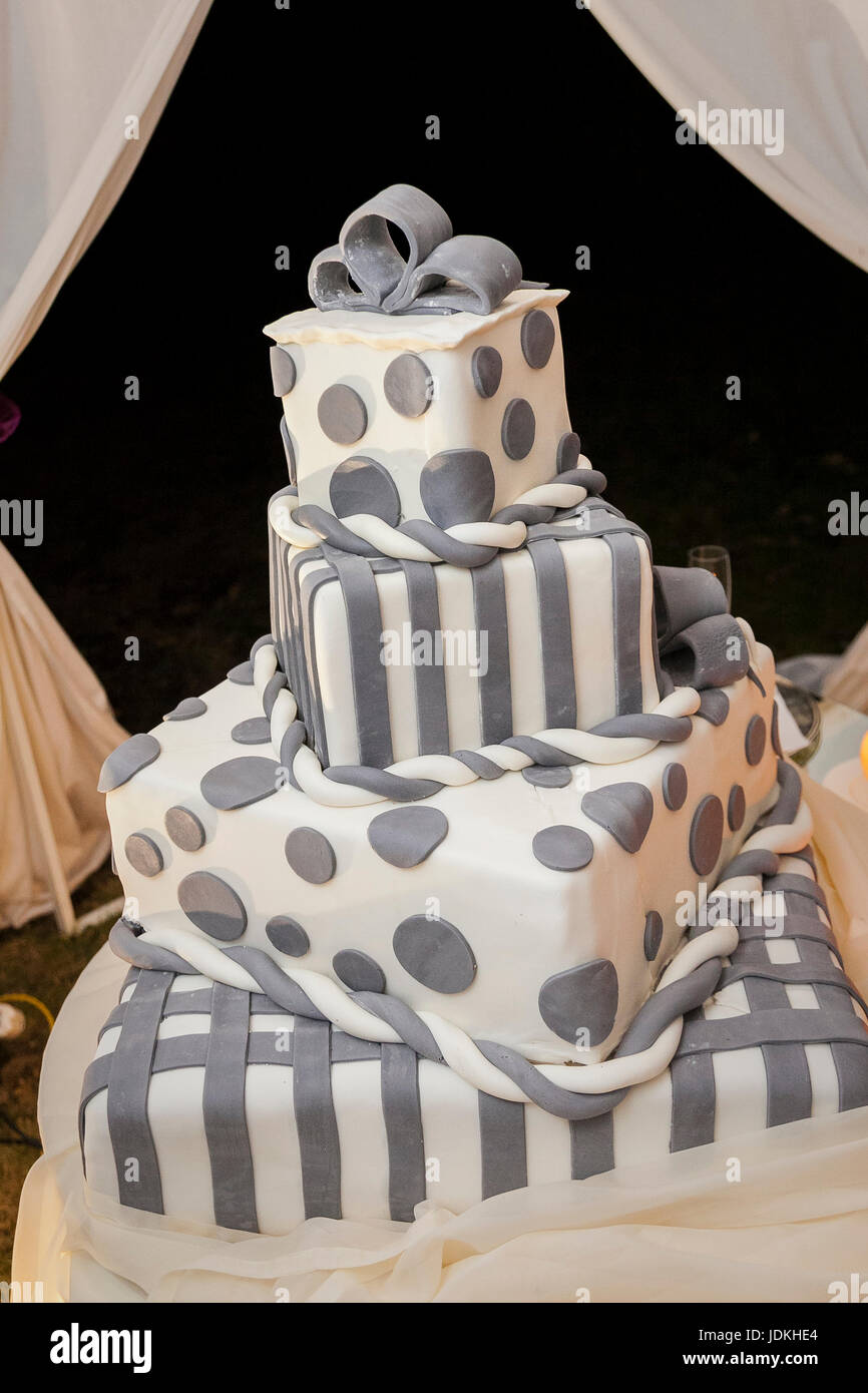 four-tiered polka dot wedding cake covered with sugar paste - Stock Image
