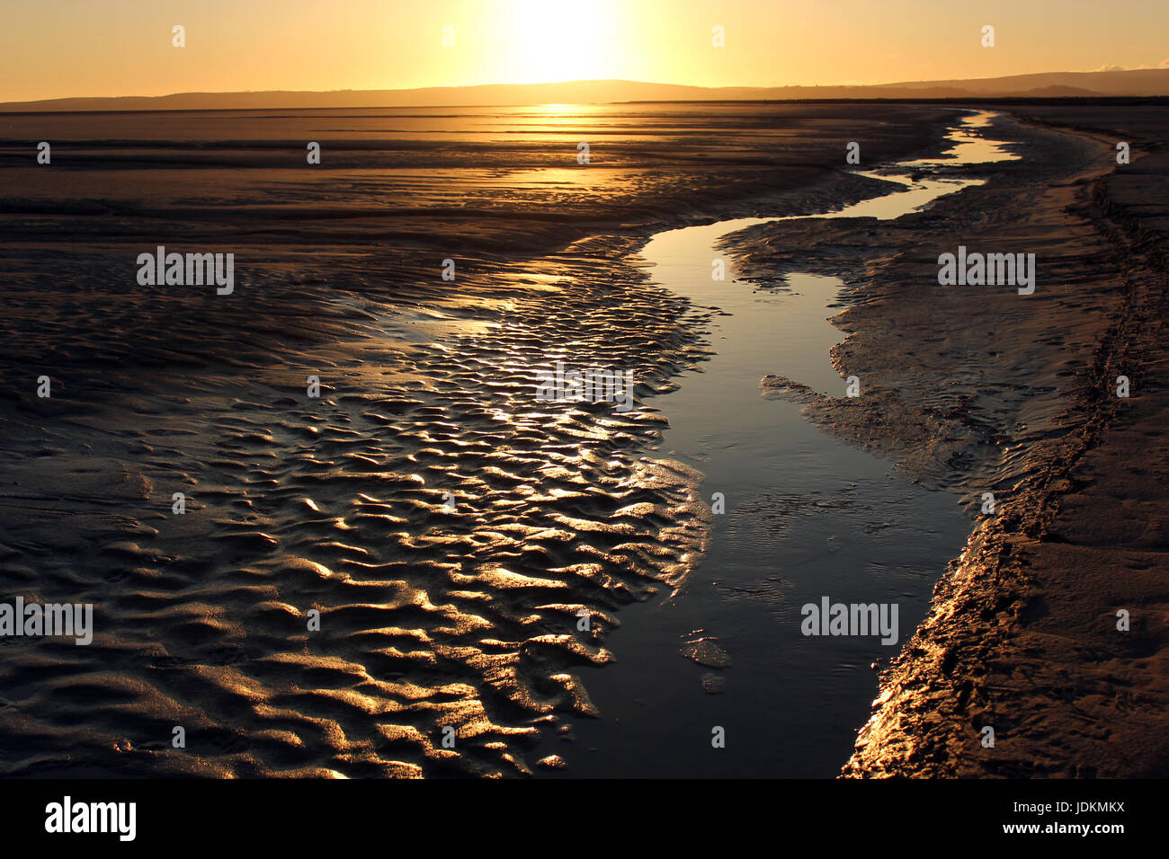 The beach at sunset at Grange-over-Sands in the parish of Lower Holker very near to the Lake District. It is a tidal Stock Photo
