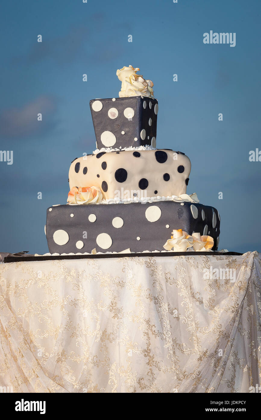 three tiered polka dot wedding cake covered with sugar paste - Stock Image