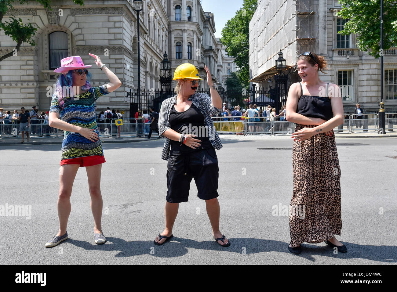 """London, UK. 21st June, 2017. Anti-Tory protesters stage a """"dance off"""" outside Downing Street following the Queen's Stock Photo"""