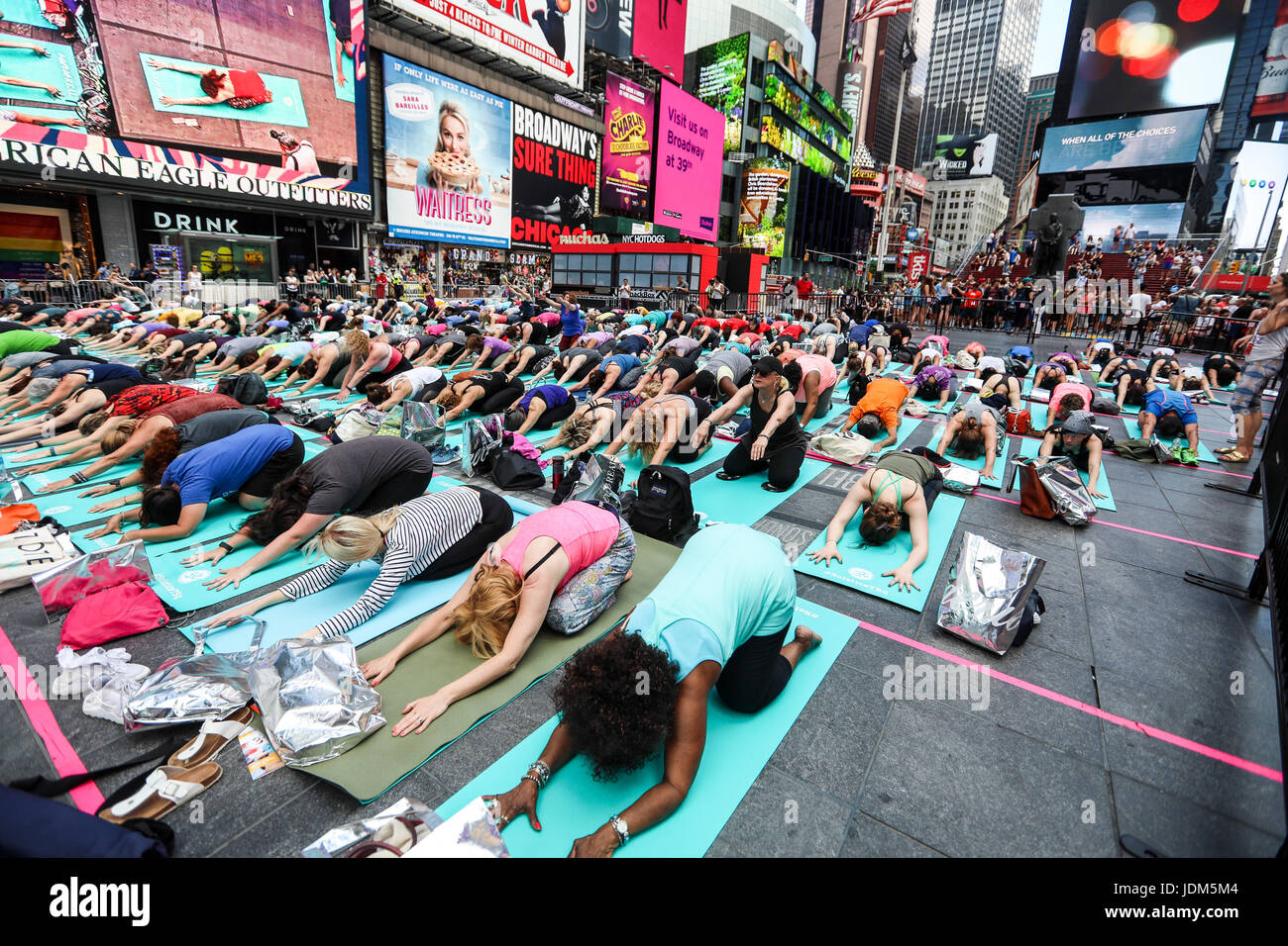 New York, United States. 21st June, 2017. People participate in a group yoga class in Times Square, June 21, 2017, - Stock Image