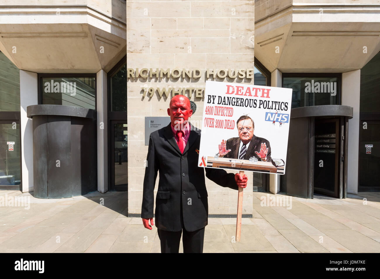 London, UK. 21st June, 2017. Tony Farrugia, painted blood red, protests outside the Department of Health at Richmond - Stock Image