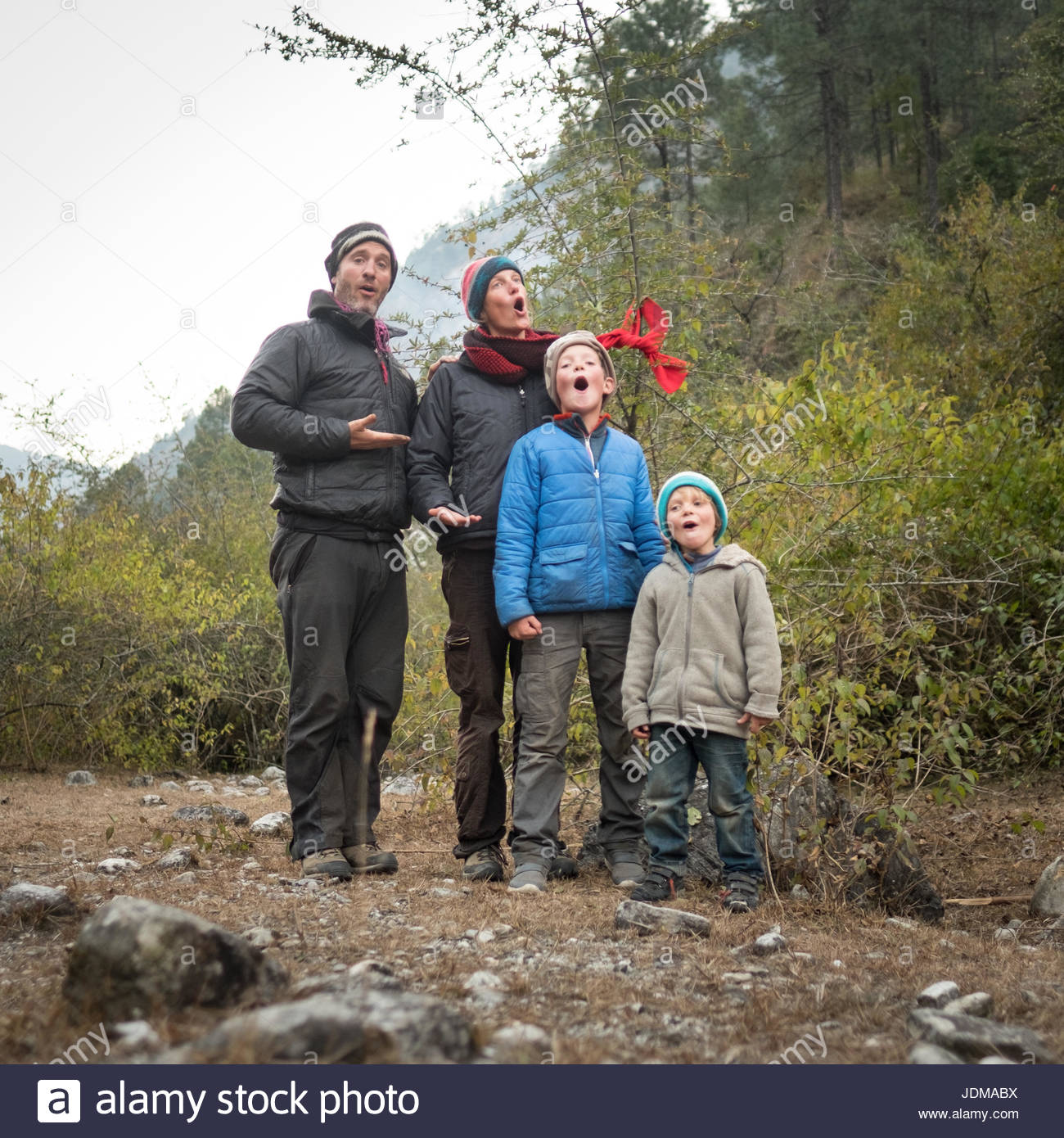 A European family sings Christmas carols while camping in India. - Stock Image