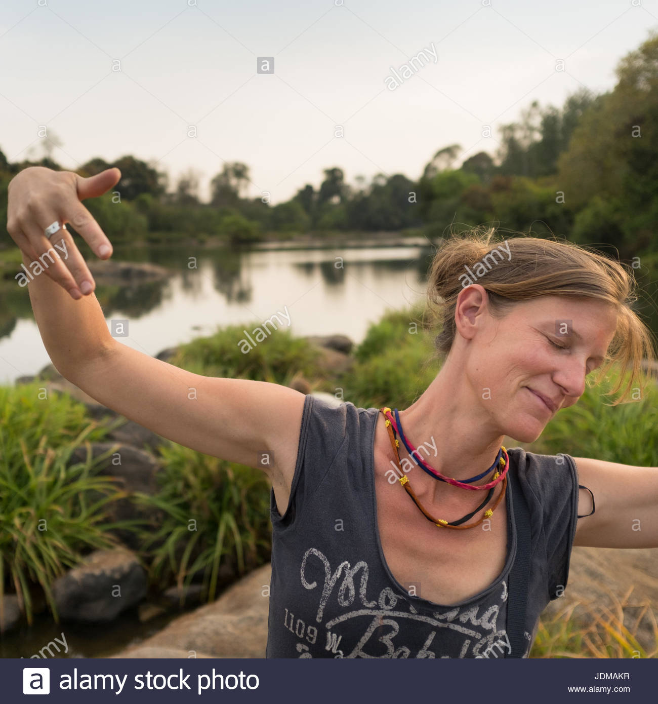 A German woman dances in the outdoors. - Stock Image
