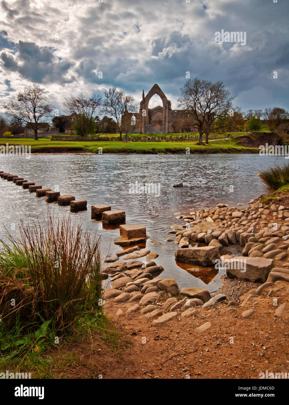 Looking across the River Wharfe at Bolton Abbey ruins - Stock Image
