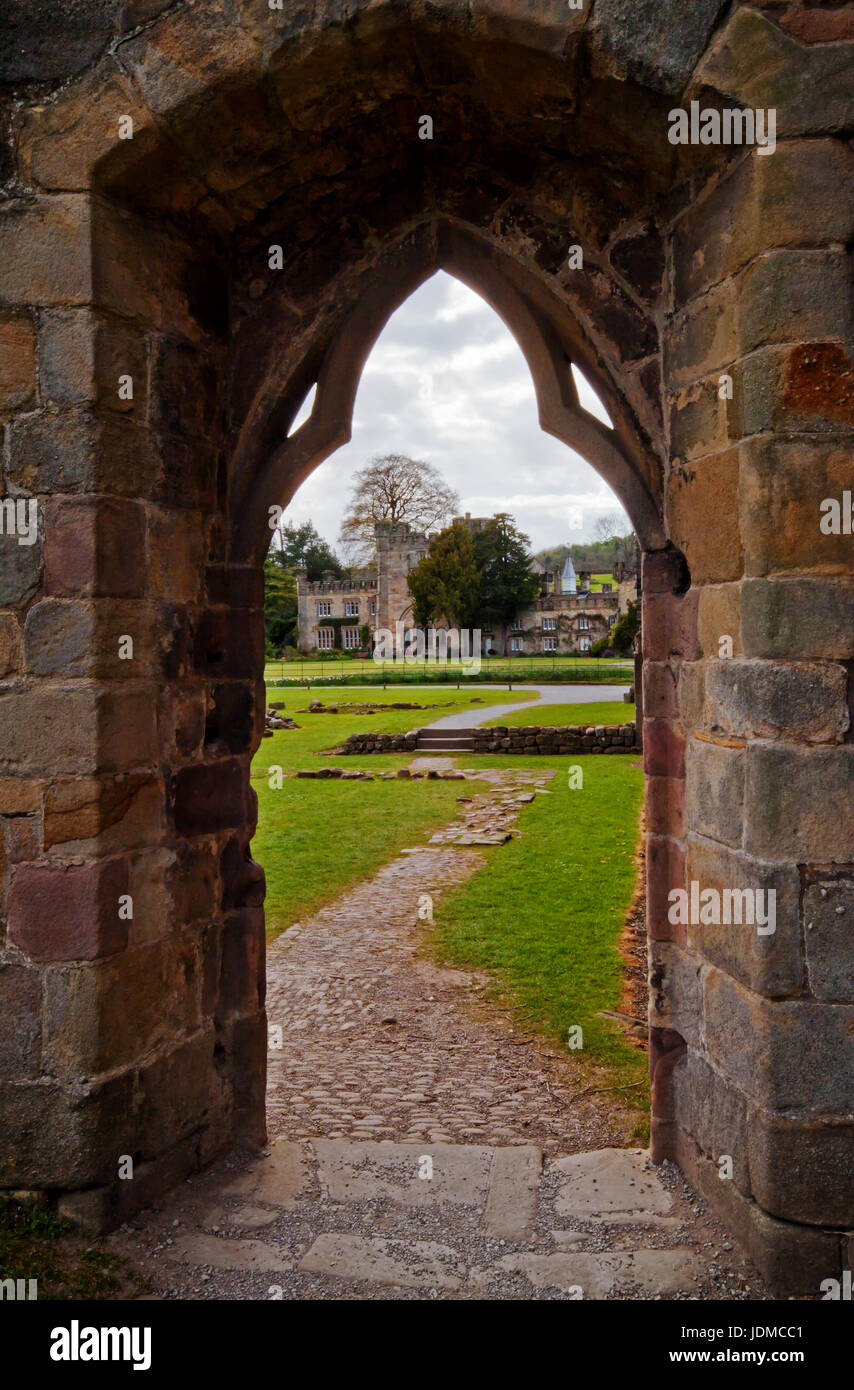Viewing the gardens of Bolton Abbey through the archway - Stock Image