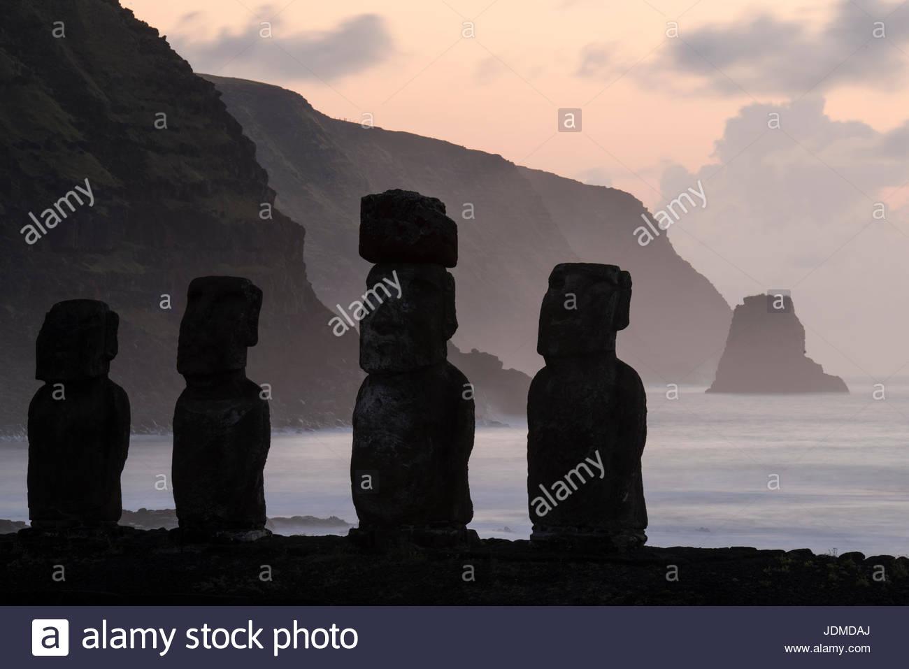 Sunrise at the Tongariki Moai site. - Stock Image