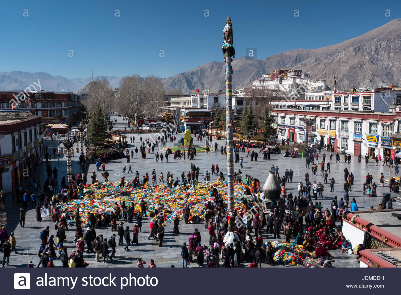 Discarded prayer flags from monasteries are put out in Barkhor Square for people to take home. - Stock Image