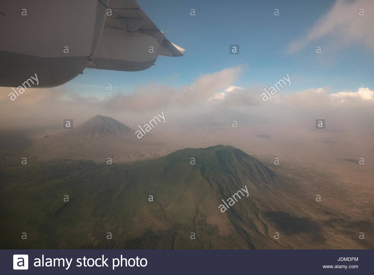 A jet in flight above the volcanoes of Tanzania. - Stock Image