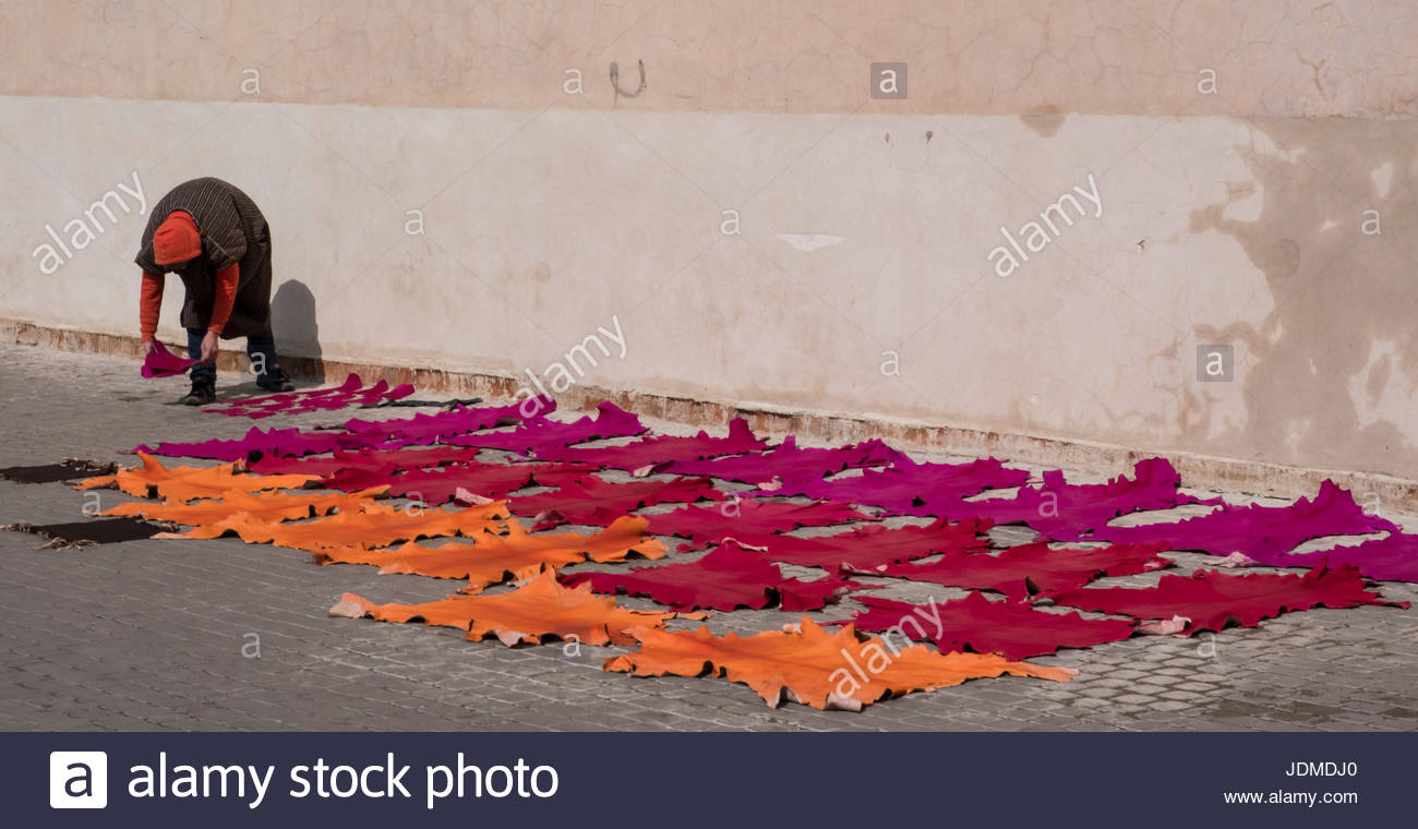 Drying leather just dyed on the streets of the Medina of Marrakesh. - Stock Image