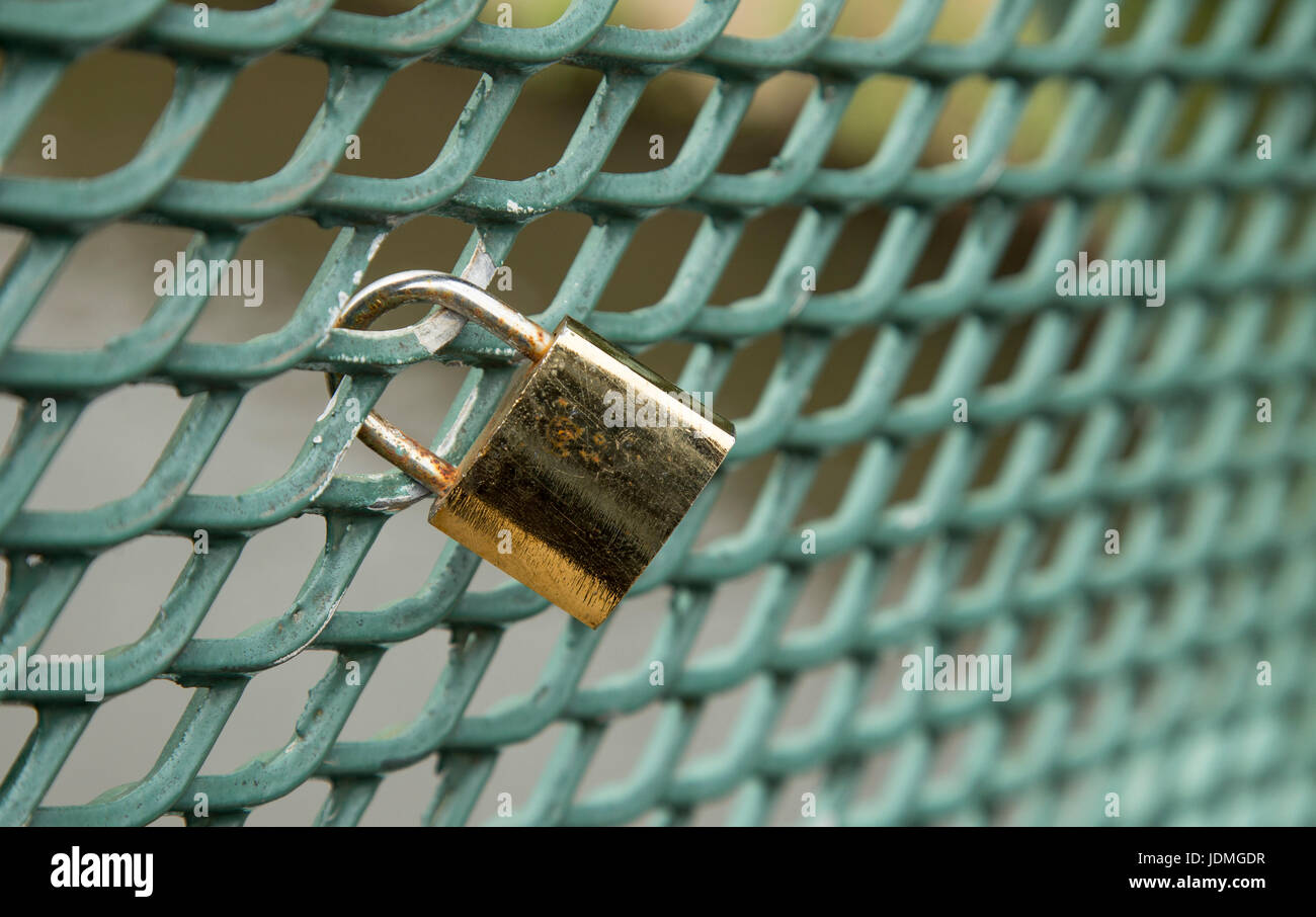 A Love Padlock attached to the side of a bridge. - Stock Image