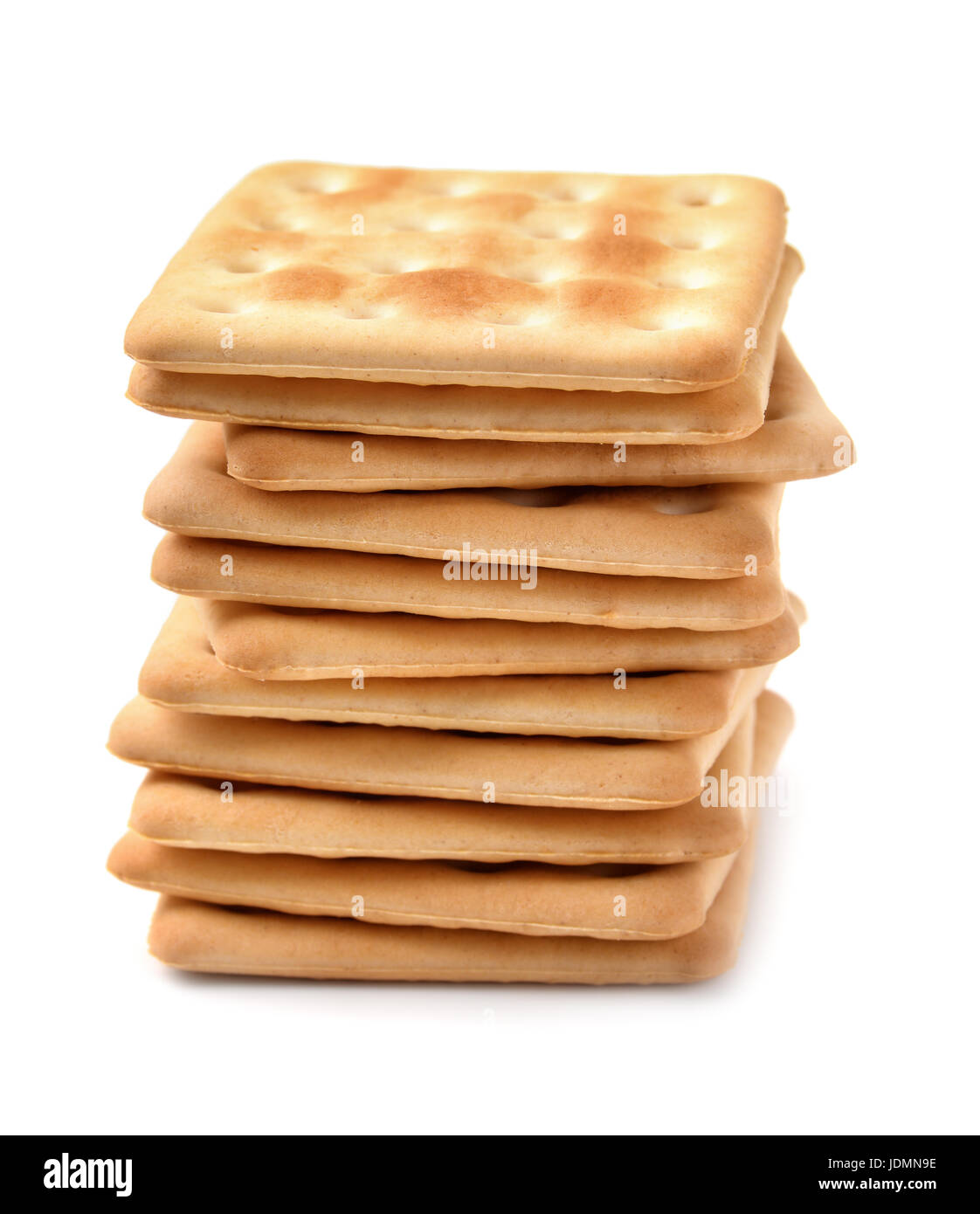 Stack of soda crackers isolated on white Stock Photo