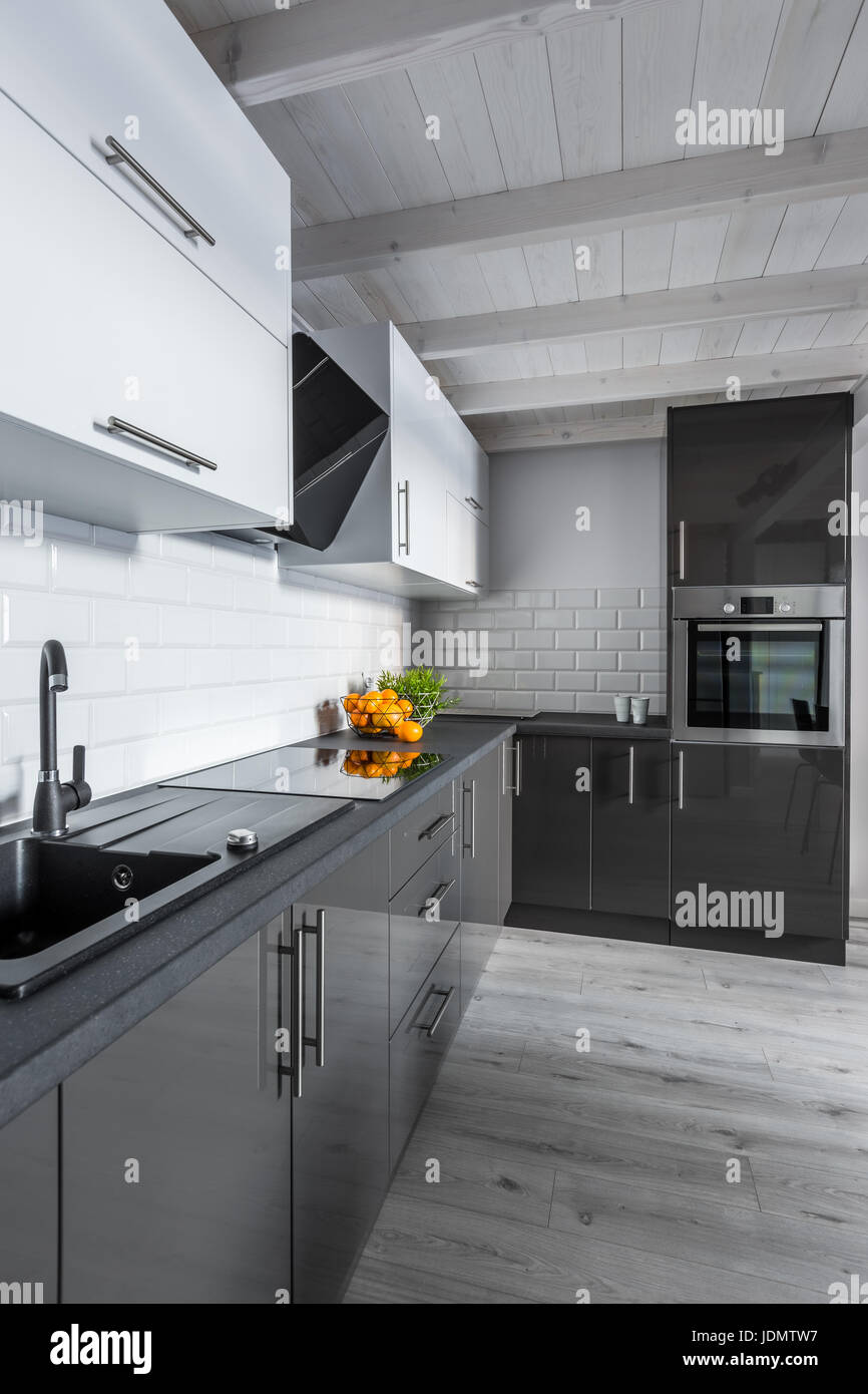 Soffitto In Legno Moderno modern, black and white kitchen with wooden ceiling stock