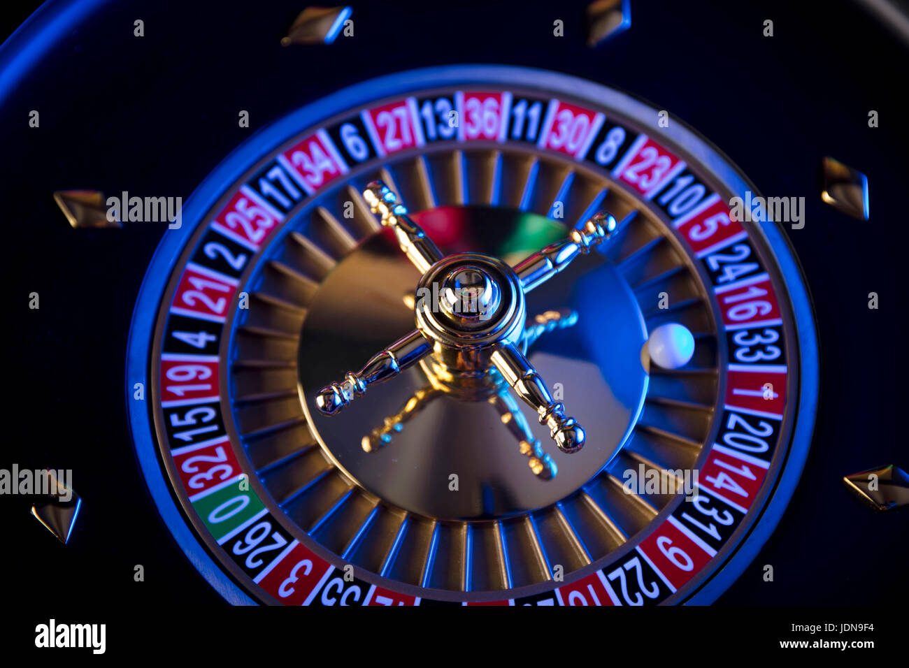 Casino blurred background. Roulette and stacks of chips. - Stock Image
