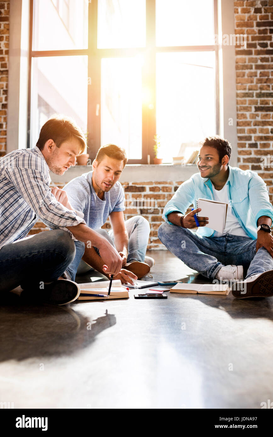 young professional group working on new business project in small business office, small business people concept - Stock Image